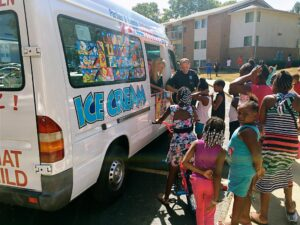 Ice cream truck serving kids